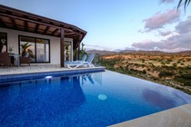 Heated Infinity Swimming Pool Barbecue Stone Build Sitting Area View of ocean River Gorge View Sun loungers Dining table